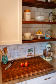 As repeat customers, their custom shelves perfectly match their custom cutting board.